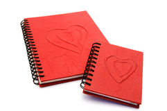 Red diary. With hearts on a white background Royalty Free Stock Photography