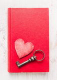 Red diary book with heart and vintage key on white wooden background, top view.  Valentines day card. Stock Photography