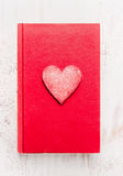 Red diary book with heart on white wooden background, top view.  Valentines day card Royalty Free Stock Images