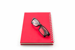 Red Diary Book with old glasses. Stock Photo