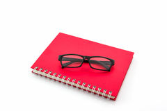 Red Diary Book with old glasses. Royalty Free Stock Image
