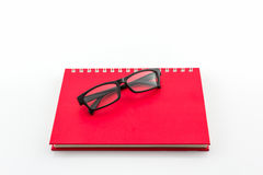 Red Diary Book with old glasses. Royalty Free Stock Photos