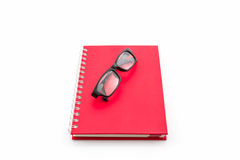 Red Diary Book with old glasses. Royalty Free Stock Photo