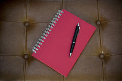 Red diary on brown leather Stock Photo