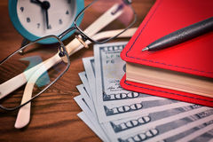 Red diary and dollar Royalty Free Stock Photos