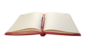 Red diary and pen Royalty Free Stock Photography