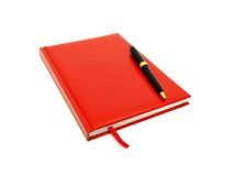 Red diary and pen on a white Stock Photography