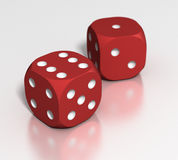 Red Dice. Pair of red playing dice Royalty Free Stock Image