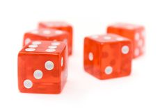 Red Dice. Translucent red dice isolated on a white background. Shallow depth of field Royalty Free Stock Image