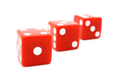 Red dice. Three red dice aligned over a white surface royalty free stock photo