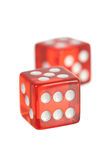 Red dice. Two red dice on white stock image