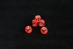 Red dice on black background Royalty Free Stock Photos