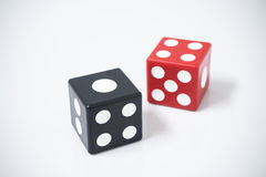 Red dice and black dice Stock Photo