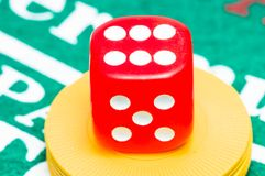 Red dice. In a casino stock photos
