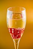 Red dice in a champagne flute Royalty Free Stock Image