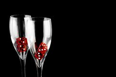 Red dice in a champagne glass Royalty Free Stock Photo