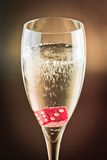 Red dice in a champagne glass Stock Image