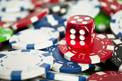 Red dice on chips close up Royalty Free Stock Image