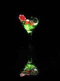 Red dice in a cocktail glass on black background. casino series Stock Image