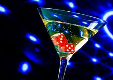 Red dice in the cocktail glass on blue light casino concept Royalty Free Stock Photo