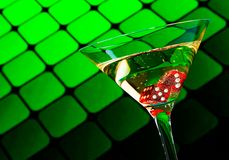 Red dice in the cocktail glass on blur green Royalty Free Stock Photos