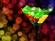 Red dice in a cocktail glass on bokeh background. casino series Stock Images