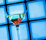 Red dice in the cocktail glass, casino concept Royalty Free Stock Images