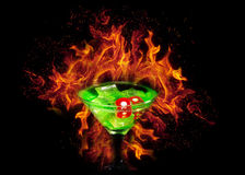 Red dice in a cocktail glass on Fire background. casino series Stock Photography