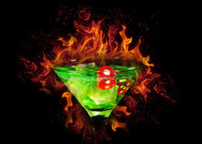 Red dice in a cocktail glass on Fire background. casino series Stock Images