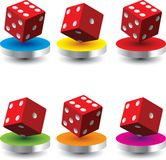 Red dice on colored discs Stock Image