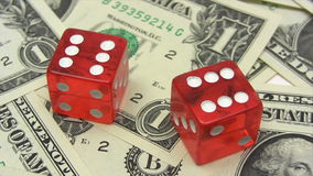 Red Dice on Dollars Stock Image