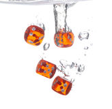 Red Dice Drop into Water Stock Photography