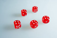 Red dice on the glass. Five dice with the value of `four`. Successful throw. Five red dice are on the table Stock Photo