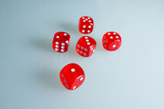 Red dice on the glass. Five dice with the value from `one` to `five`. Successful throw. Five red dice are on the table Royalty Free Stock Photos