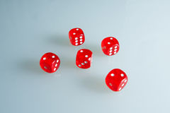 Red dice on the glass. Five dice with the value of `two`. Successful throw. Five red dice are on the table Stock Images