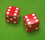 Red dice on green cloth Stock Photography