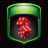 Red dice in green display Stock Photos