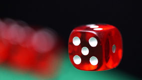 Red dice on a green felt Royalty Free Stock Image