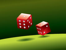 Red dice on green table Stock Photo