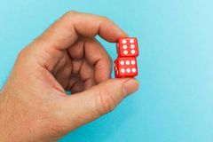 Red dice in hand, good luck royalty free stock photos
