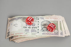 Red dice on Indian Currency Rupee bank notes Royalty Free Stock Images