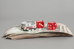 Red dice on Indian Currency Rupee bank notes Stock Images