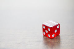 Red Dice Isolated on Desktop Stock Photo