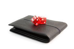 Red dice on the leather wallet Royalty Free Stock Photos