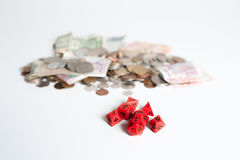 Red dice and money Stock Photography