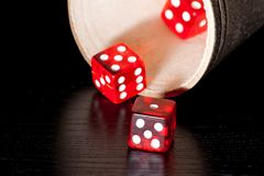 Red dice on old wood black table near a container Royalty Free Stock Images