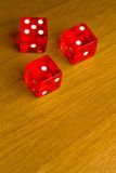 Red dice on old wood desk Stock Photos
