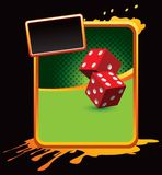 Red dice on orange splattered advertisement Royalty Free Stock Photo