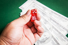 Red dice over green surface image close up Stock Images