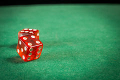 Red dice over green surface image close up Royalty Free Stock Photo